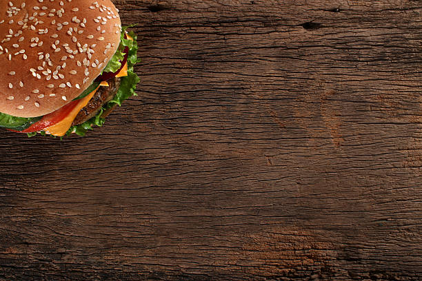 Tasty hamburger on wood background  Space for text stock photo