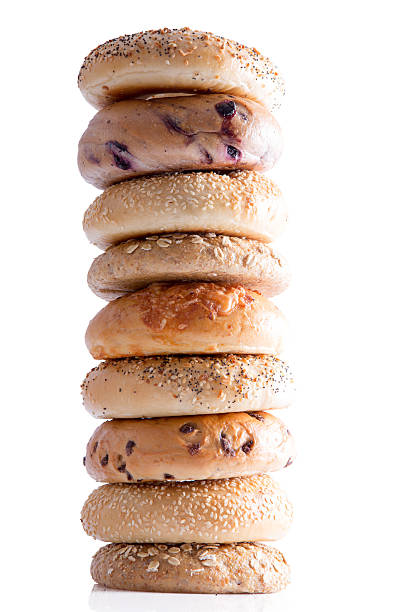 Tasty Homemade Bagel Breads Piled Vertically - Photo