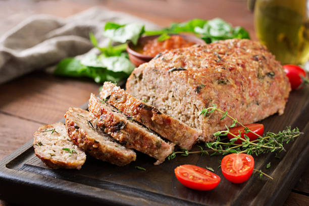 Tasty homemade ground  baked turkey meatloaf on wooden table. Food american meat loaf. stock photo