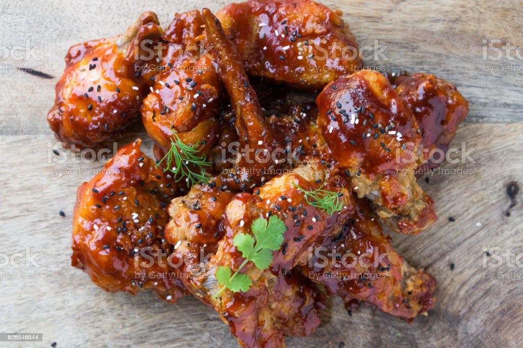 Tasty homemade Korean deep fried chicken with spicy sauce. stock photo