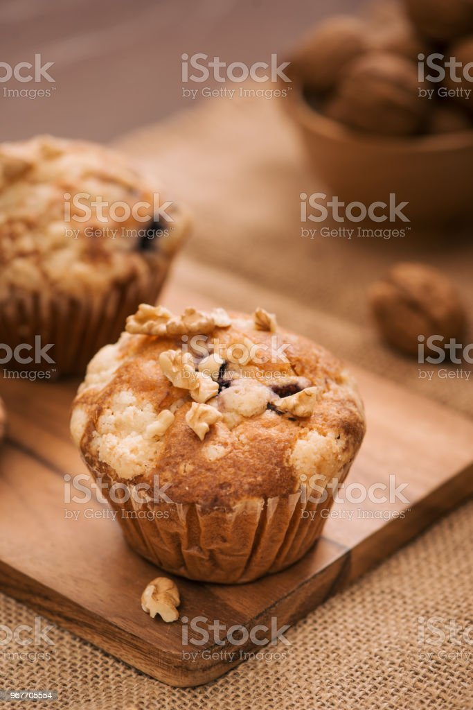 Tasty homemade walnut muffins on table. Sweet pastries stock photo