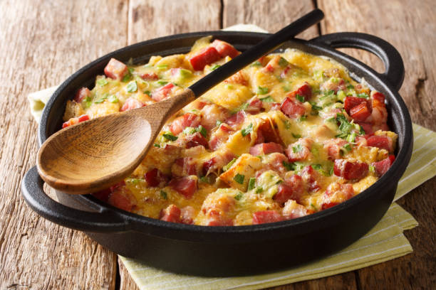 Tasty hot homemade strata with ham, onions, cheese and eggs close-up on the table. horizontal stock photo