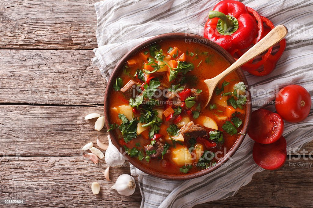 Tasty Hungarian goulash soup bograch and ingredients. horizontal stock photo