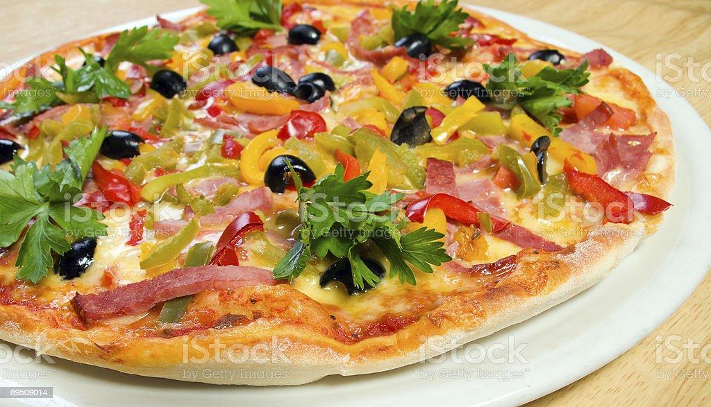 Tasty Italian pizza shallow DOF royalty-free stock photo