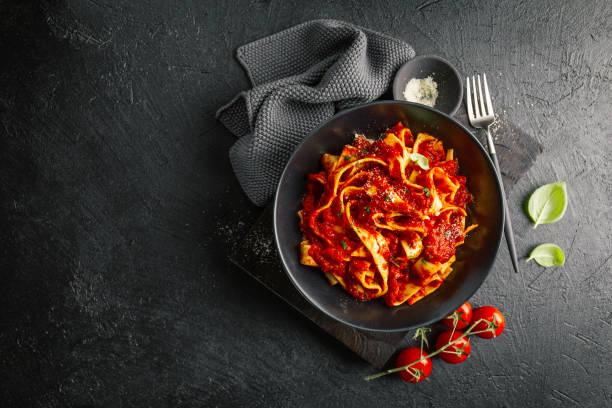 tasty italian pizza with tomato sauce and parmesan - sauce tomatoes imagens e fotografias de stock