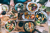 Tasty food on wooden kitchen table in rustic style