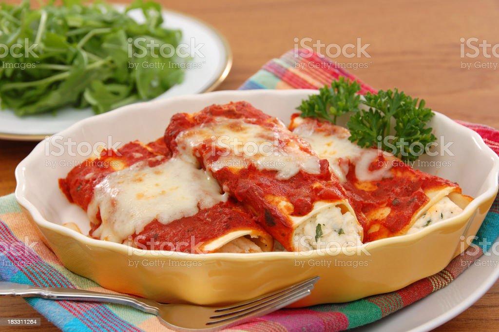 Tasty manicotti served with broccoli stock photo
