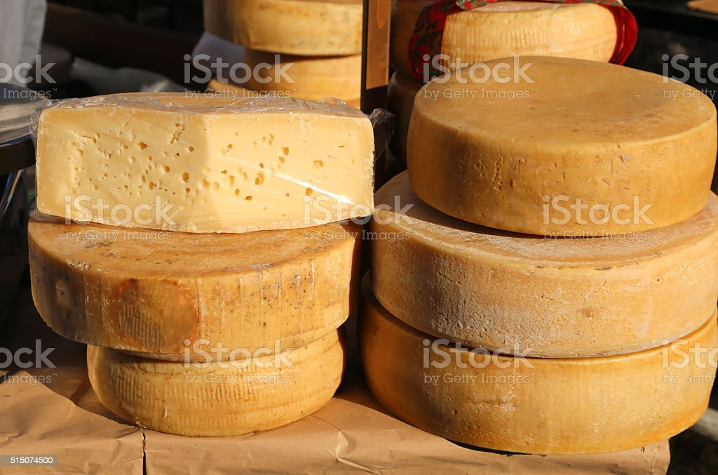 tasty mature cheese with holes for sale in the market stock photo