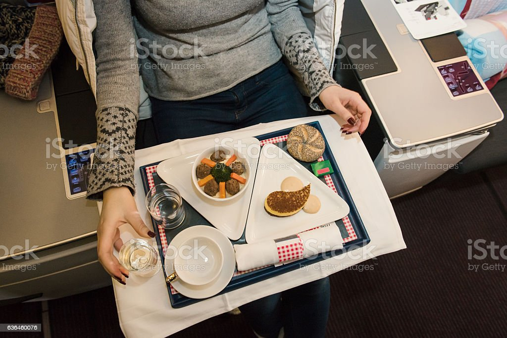Tasty meal served on board of airplane on the table. stock photo