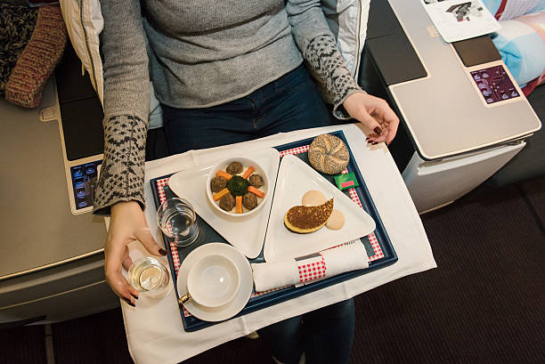 Tasty meal served on board of airplane on the table. - Photo