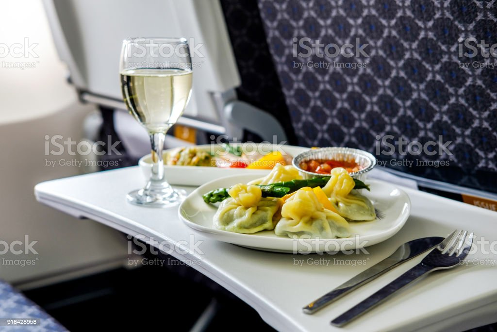 Tasty meal served on board of airplane on the table stock photo