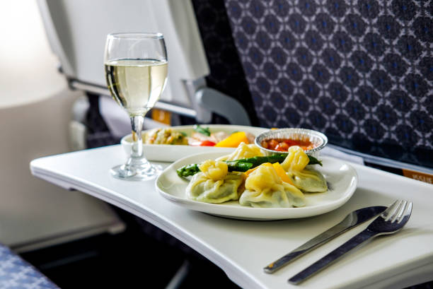 Tasty meal served on board of airplane on the table Tasty meal served on board of airplane on the table first class stock pictures, royalty-free photos & images