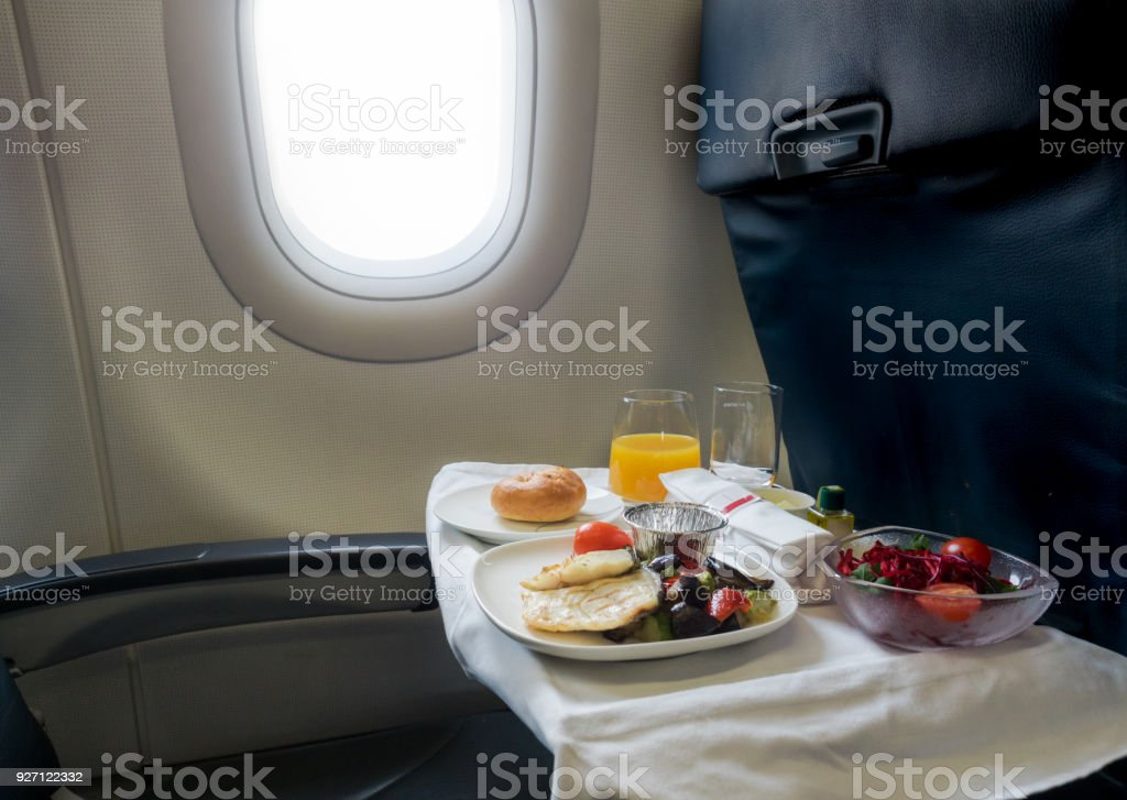 Tasty meal served on board of airplane stock photo