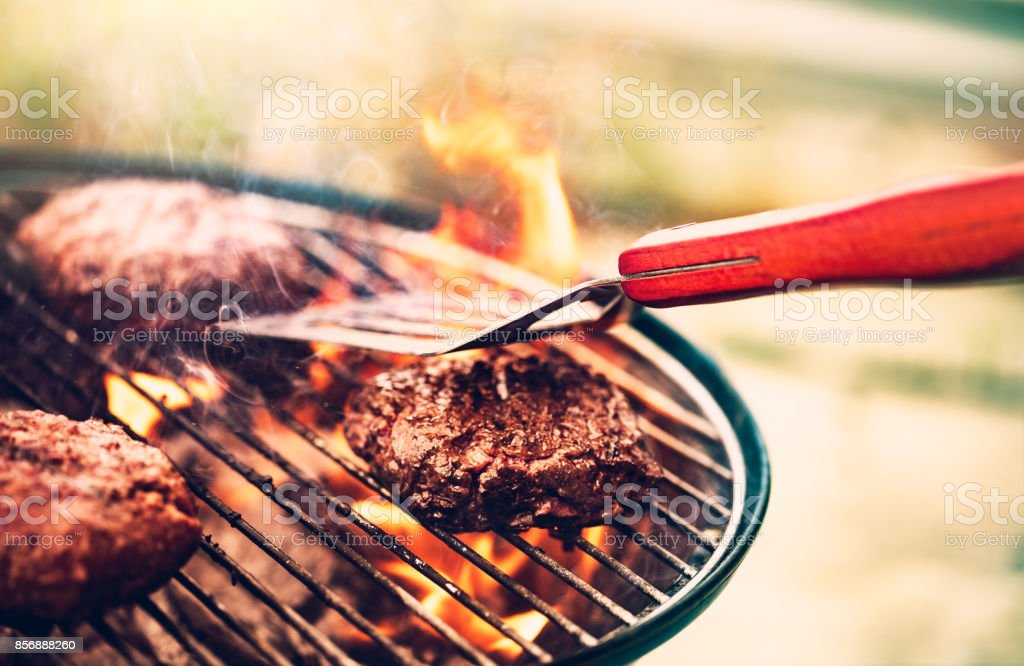 Tasty meat on the grill stock photo
