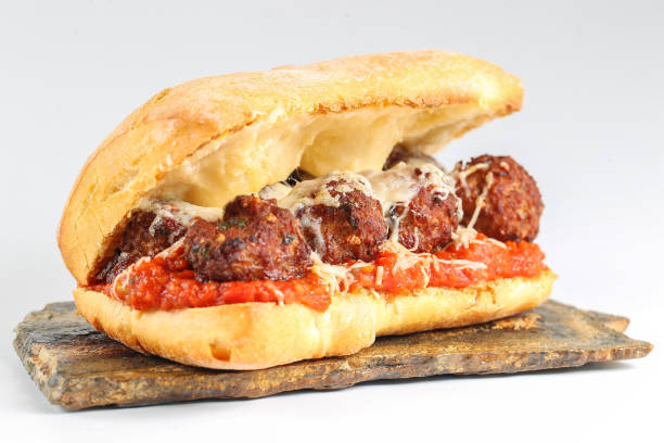 Tasty meatballs sandwich in a ciabatta Tasty meatballs sandwich in a ciabatta with tomato sauce and parmesan meatball stock pictures, royalty-free photos & images