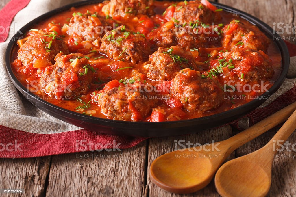 Tasty meatballs with spicy tomato sauce on a dish close-up stock photo