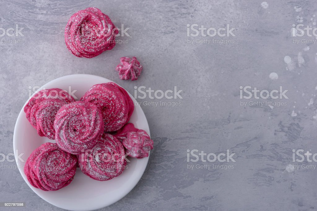 Tasty meringues cookies on plate stock photo