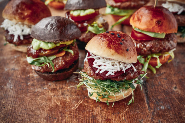 tasty mini burgers - sliding stock photos and pictures