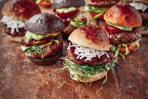 Tasty Mini Burgers Tasty Mini Burgers slider burger stock pictures, royalty-free photos & images
