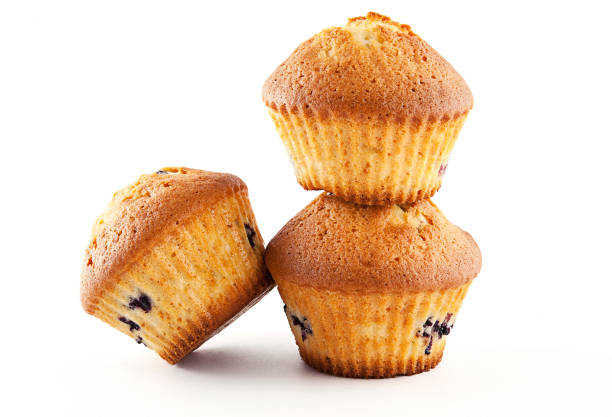 tasty muffins isolated on white background - muffin foto e immagini stock