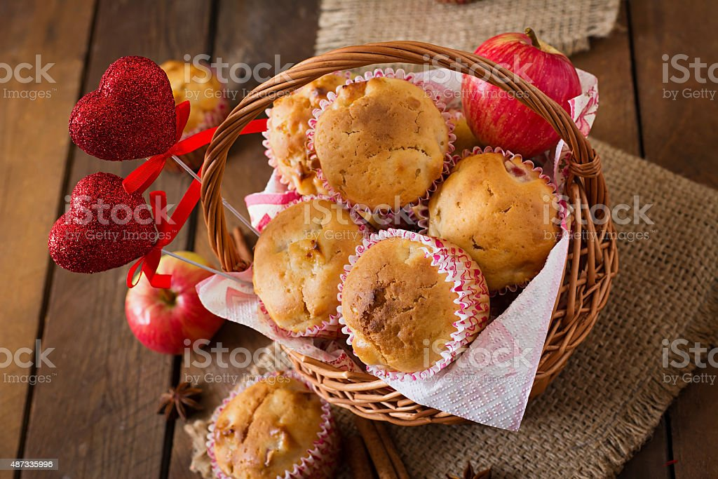 Tasty muffins with apple and cinnamon stock photo
