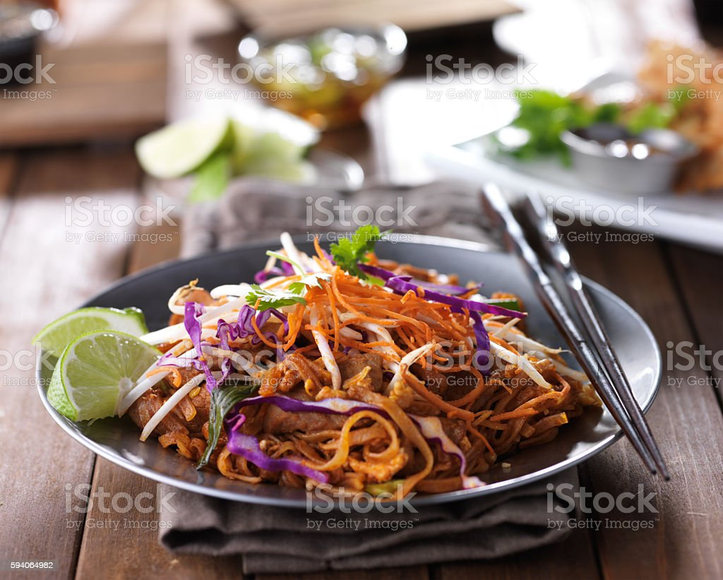 tasty pad thai stir fry with beef and colorful garnish stock photo