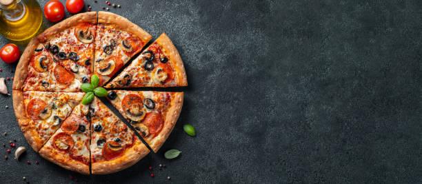 tasty pepperoni pizza with mushrooms and olives. - pizza стоковые фото и изображения