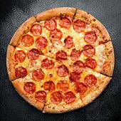 istock Tasty Pepperono Pizza On Black Concrete Background 1167344015