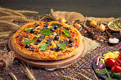 istock Tasty pizza with chicken, vegetables and olives 1008257254