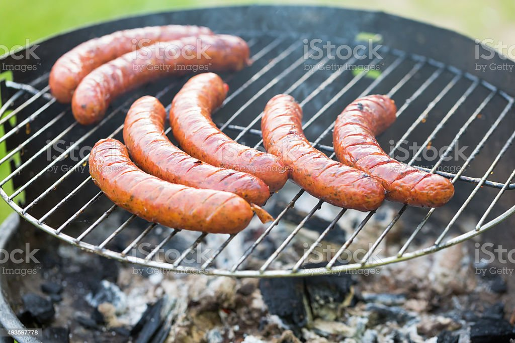 Tasty polish sausage on grill