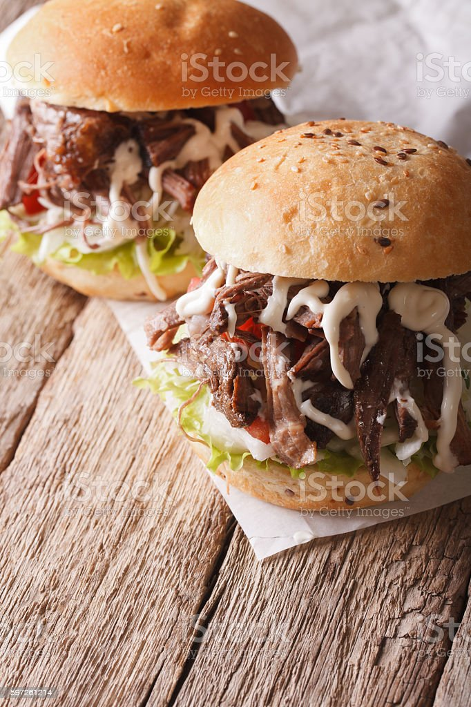 Tasty Pulled pork sandwich with coleslaw and sauce closeup stock photo