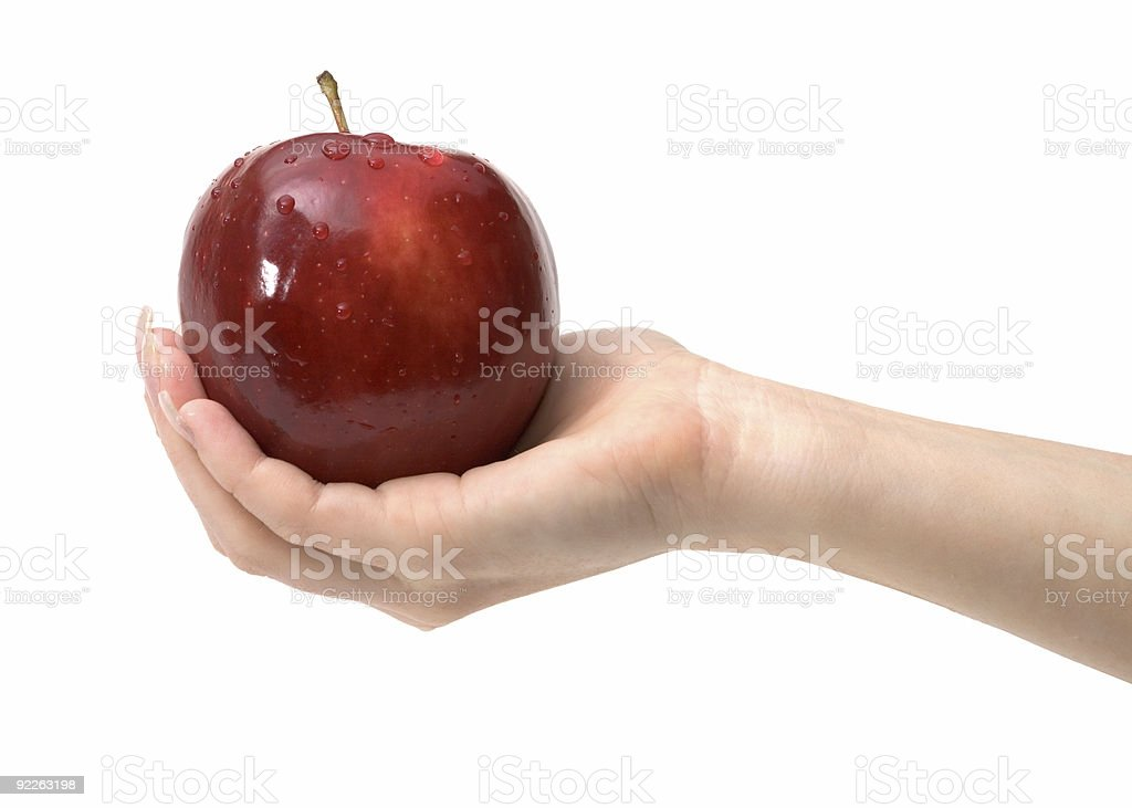 Tasty red apple in woman's hand on white, isolated royalty-free stock photo