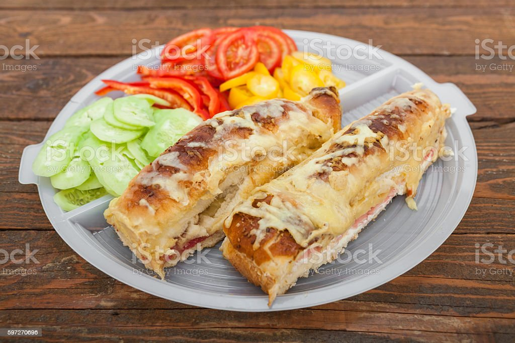 Tasty sandwich with ham, melted cheese and vegetables Lizenzfreies stock-foto