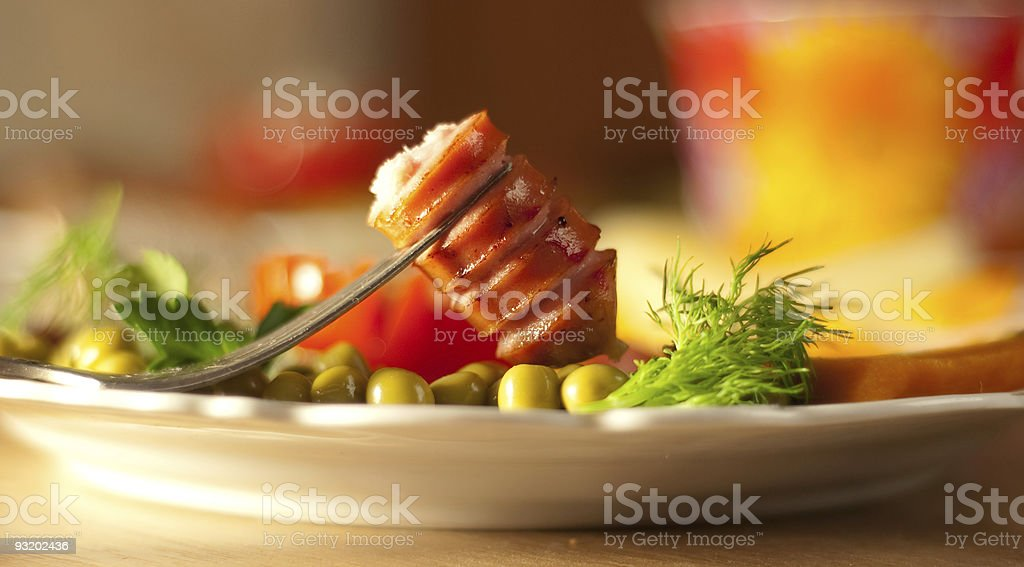 Tasty sausage with vegetables royalty-free stock photo