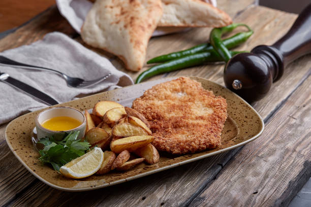 Tasty schnitzel with boiled potato. Top view, flat lay food stock photo
