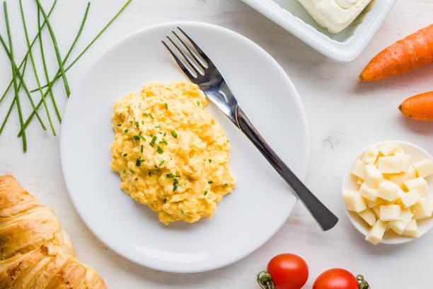 tasty scrambled eggs stock photo