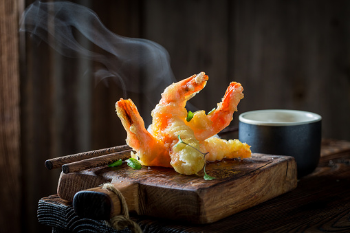 Tasty Shrimp In Tempura With Red Sauce On Black Background Stock Photo - Download Image Now