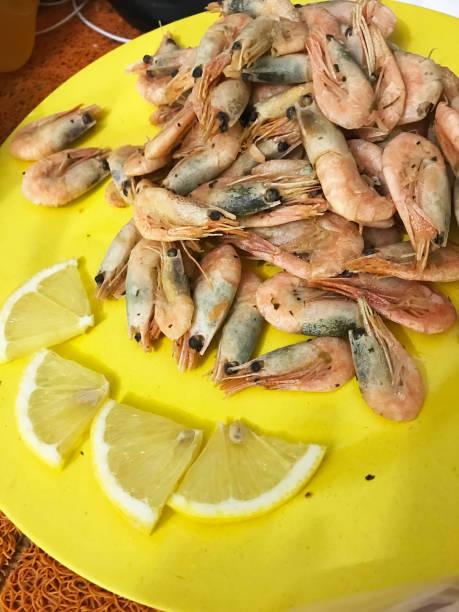 Tasty shrimps with lemon on a plate picture id654244662?b=1&k=6&m=654244662&s=612x612&w=0&h=jezirch7n0bim1qjpwf 8texil4ciz7aasiulk reqe=