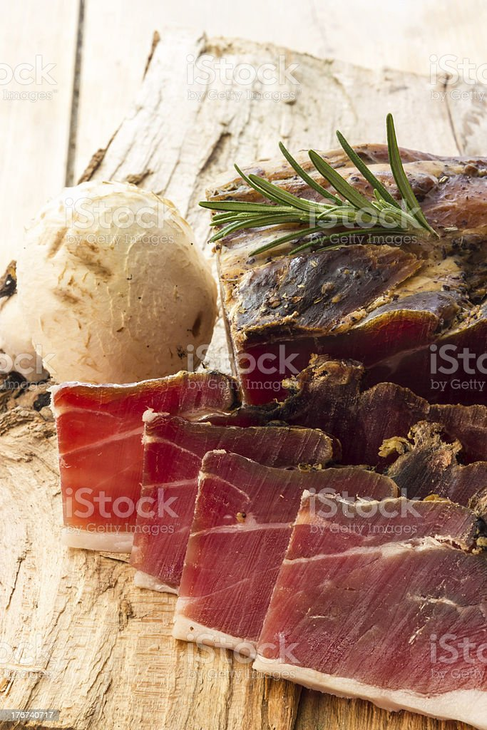 Tasty slices of Italian speck royalty-free stock photo