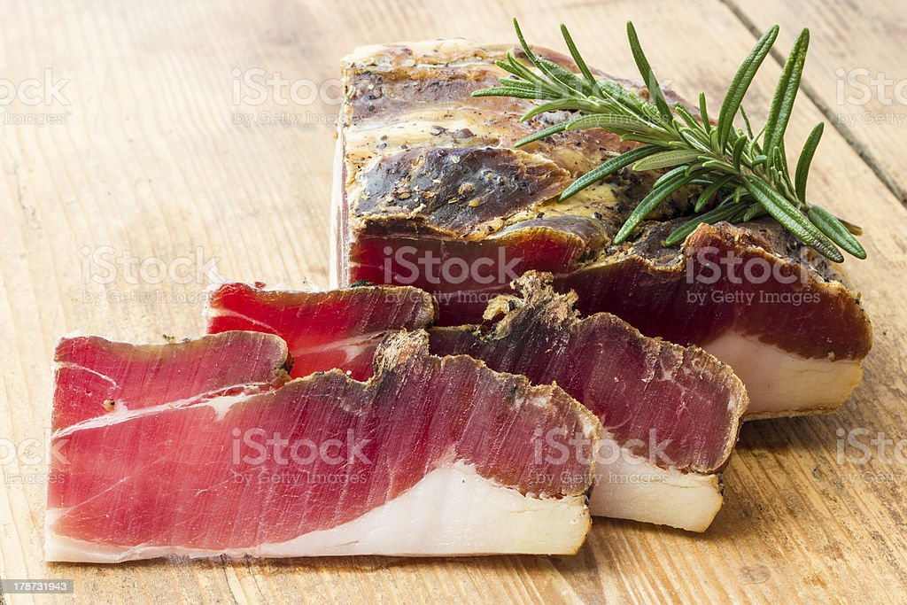 Tasty slices of Italian speck stock photo