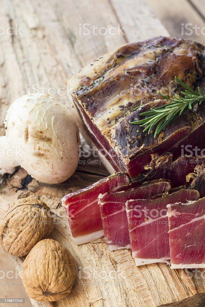 Tasty slices of Italian speck royalty-free stock photo