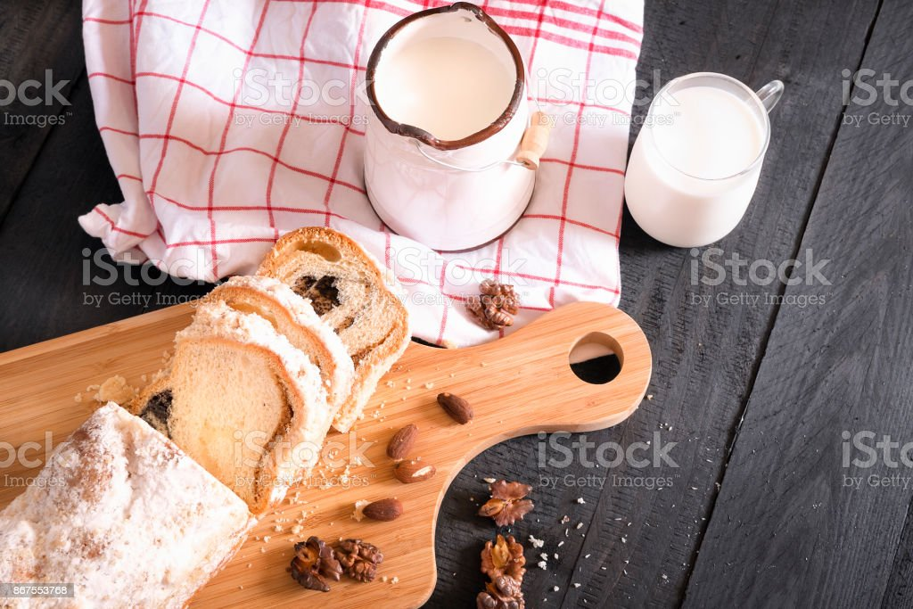 Tasty snack with milk and sponge cake stock photo