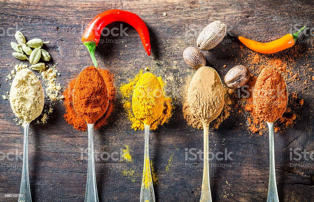 Tasty spices and herbs on old spoons – Foto