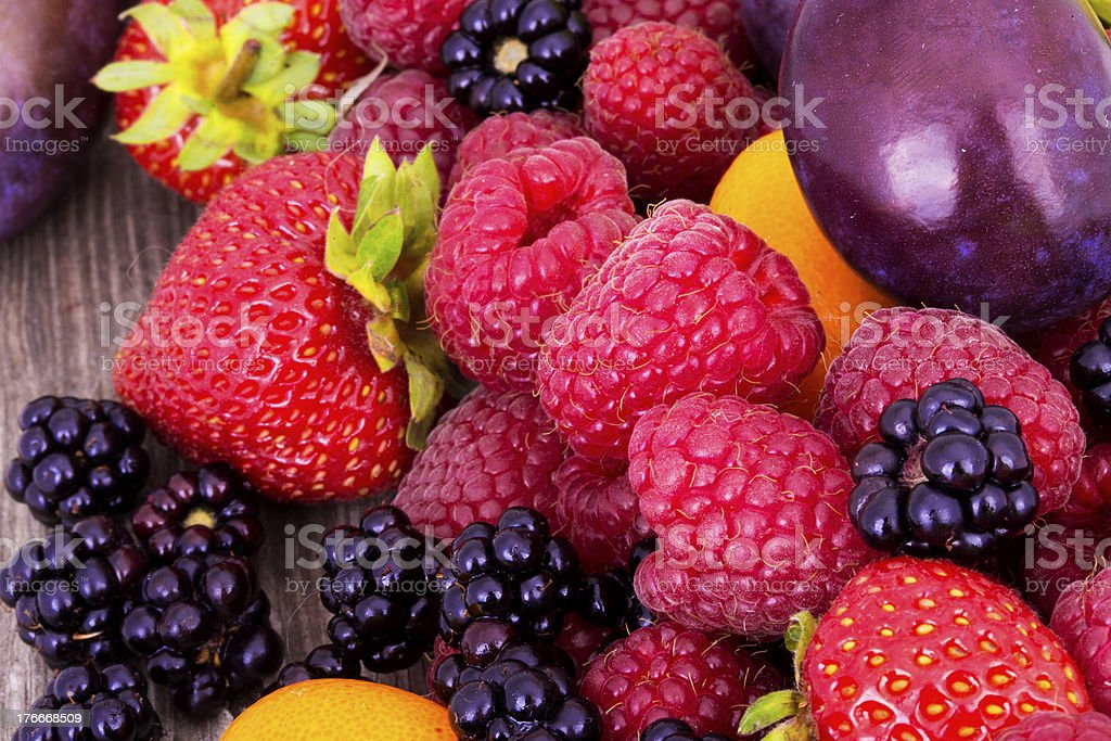 tasty summer fruits on a wooden table royalty-free stock photo
