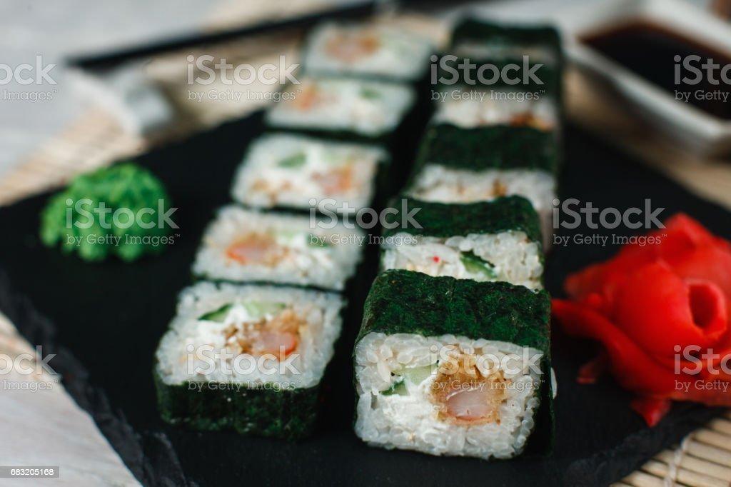 Tasty sushi maki served on black slate, close up 免版稅 stock photo