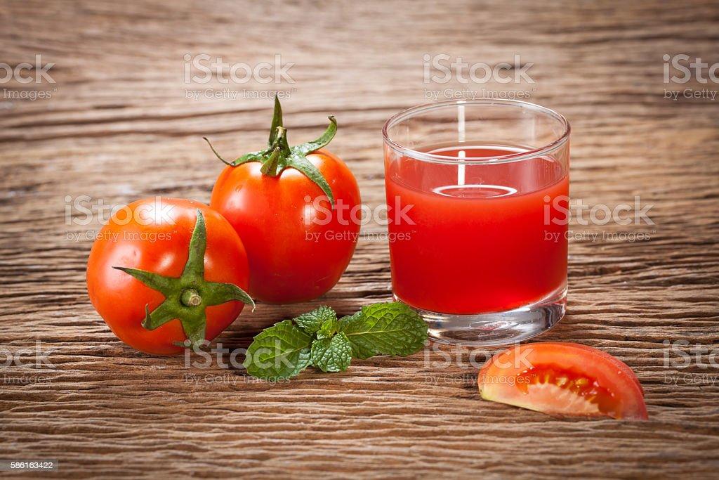 Tasty tomato juice and tomato's. stock photo