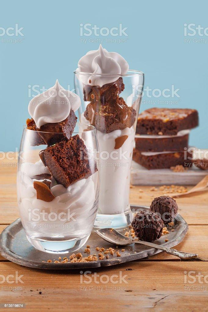 tasty vanilla frozen yogurt with Brownie and whipped cream stock photo