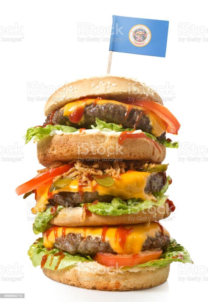 Tasty XXL Hamburger with the flag of Minnesota.(series) stock photo