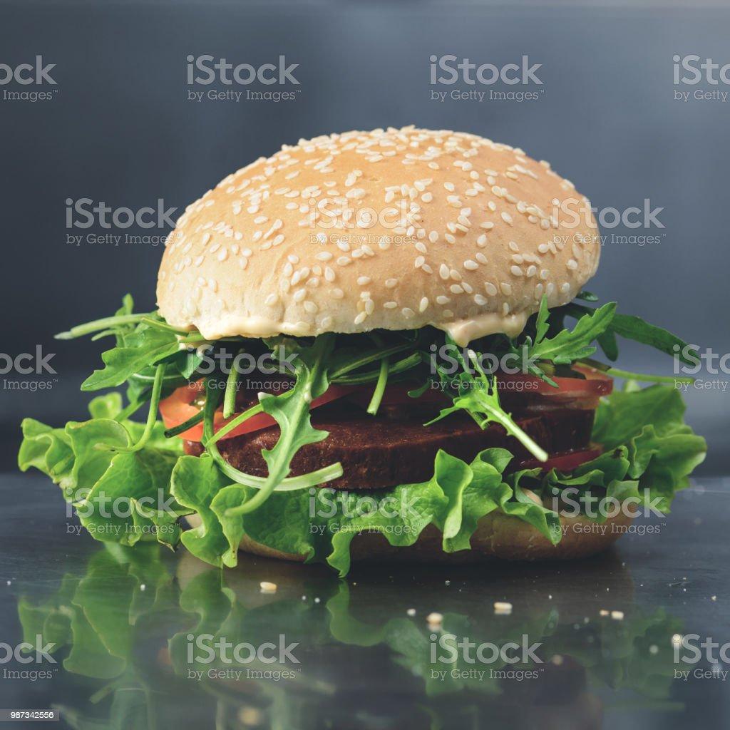 Tasty yummy veggie quinoa chickpeas burger with tomotoes, lettuc stock photo