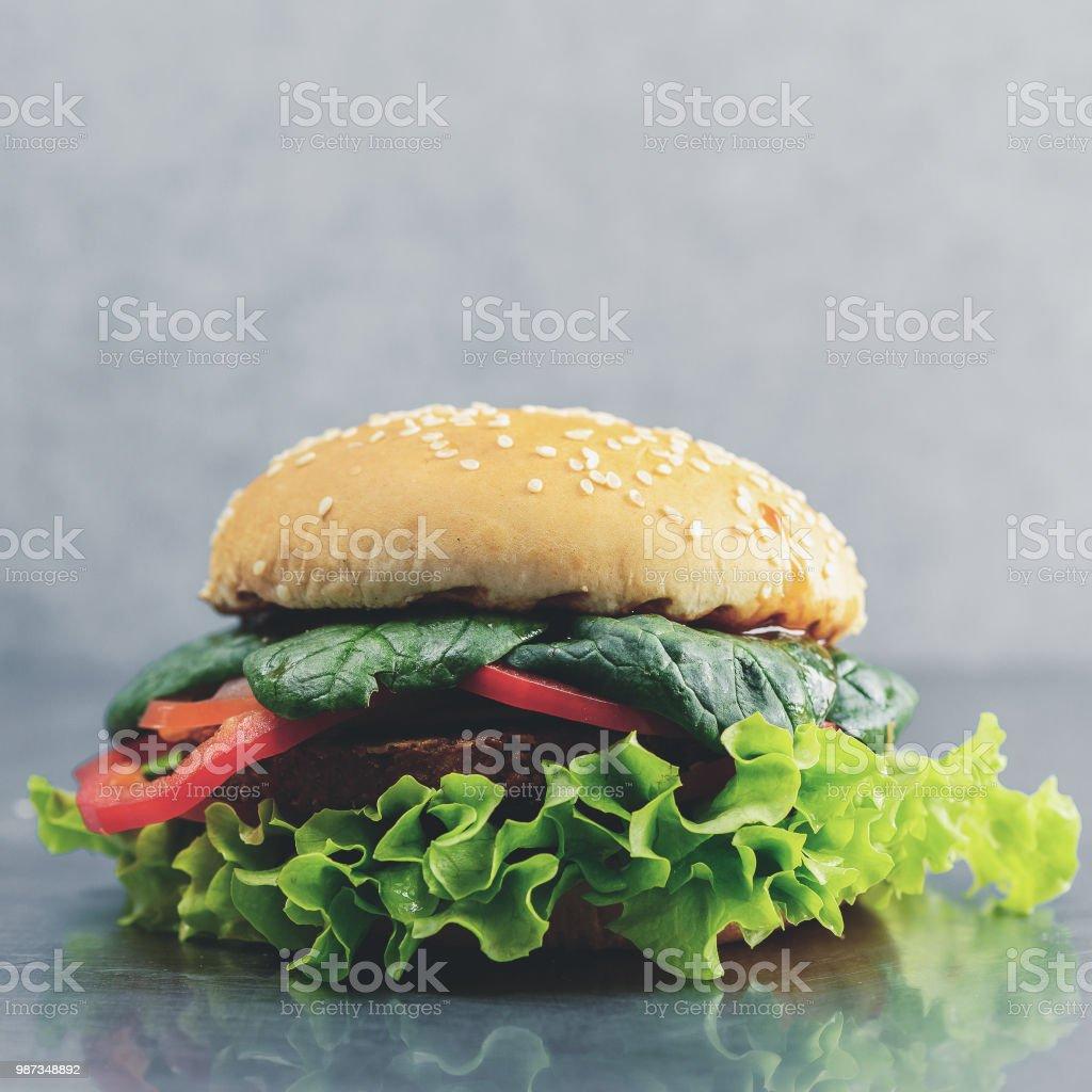 Tasty yummy veggie quinoa chickpeas burger with vegetable pattie stock photo